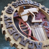 Gallery pic of the Academy of Science & Technology from Legacy Crests, by Embry McKee, maker of family crests, coats of arms, corporate logos, sports logos, sorority crests, university crests, and carved wood designs of all kinds.