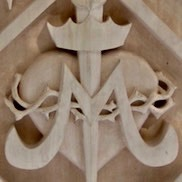 Gallery pic of the crest of Immaculate Conception Catholic School in Denton TX, by Embry McKee, maker of family, school, institutional, and corporate crests, sports logos, and other carved wood designs