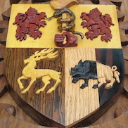 Gallery pic of the Sullivan Crest from Legacy Crests by Embry McKee, maker of family crests, coats of arms, corporate logos, sports logos, university crests, and other carved wood designs.